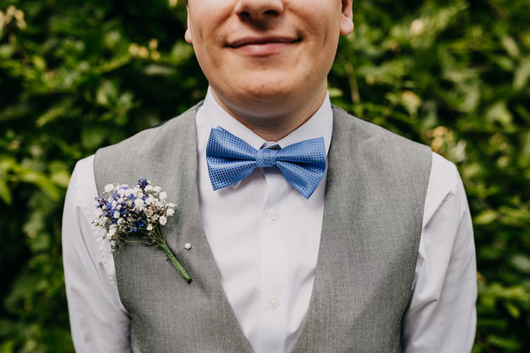 Groom Bow Tie Buttonhole Boutonniere Grey White Gypsophila | Rustic Relaxed Cornflower Blue Barn Wedding http://www.peterhugophotography.com/