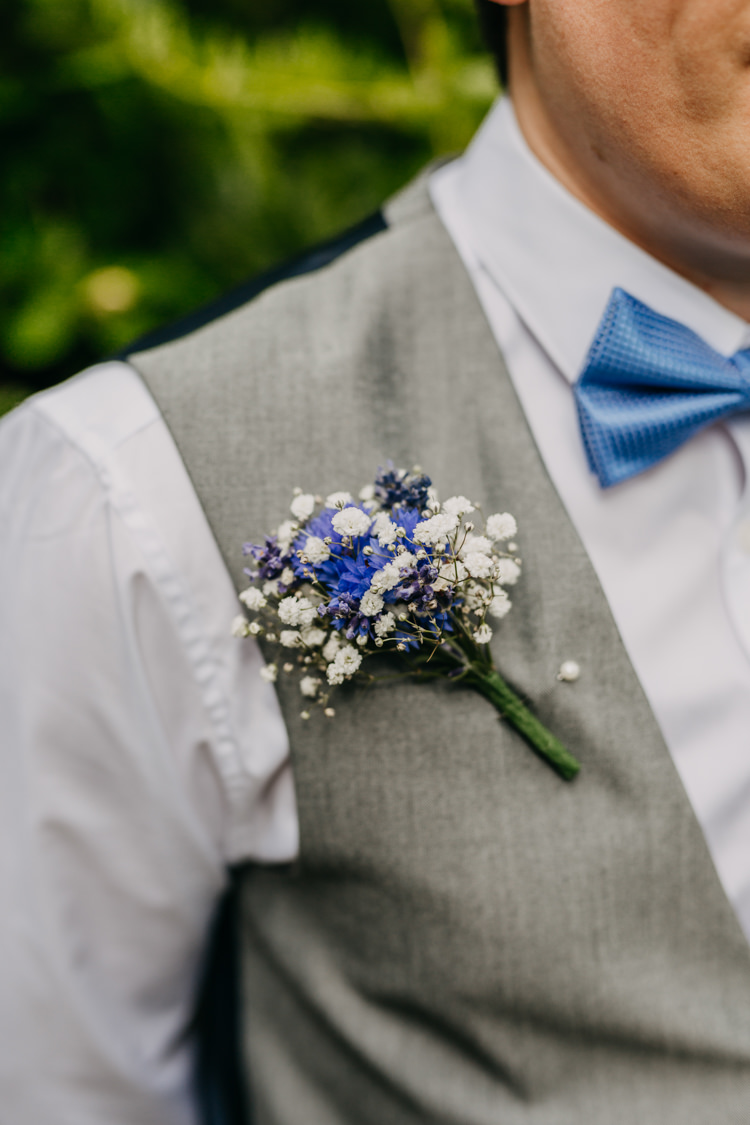 Buttonhole Boutonniere Gyp Cornflower Groom Grey Suit | Rustic Relaxed Cornflower Blue Barn Wedding http://www.peterhugophotography.com/