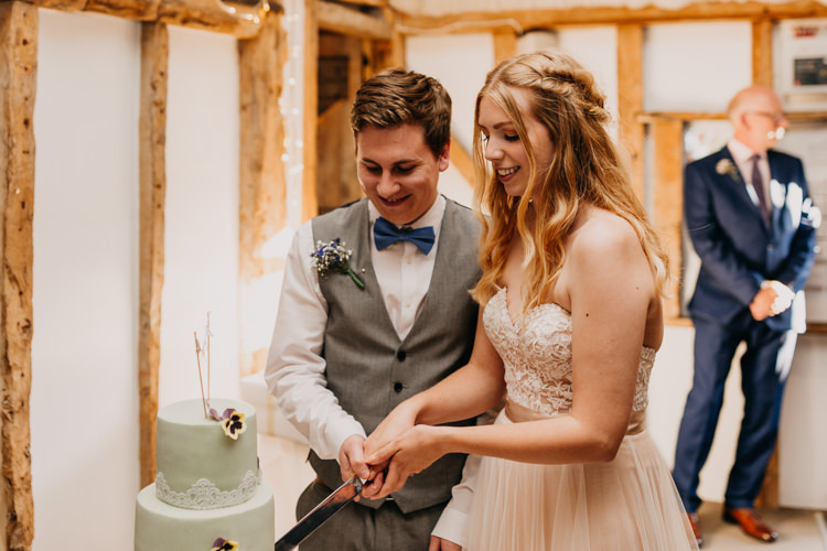 Bride Groom Cake Cutting Green Lace Flowers Simple Natural | Rustic Relaxed Cornflower Blue Barn Wedding http://www.peterhugophotography.com/