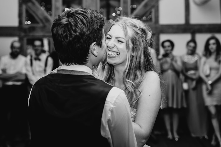 Bride Groom First Dance Laughing Black and White Informal Fun | Rustic Relaxed Cornflower Blue Barn Wedding http://www.peterhugophotography.com/