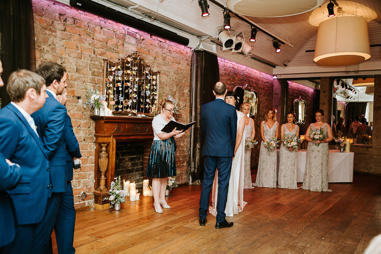 Urban Decor Ceremony Hanging Floral Curtain Bride Groom Celebrant | Glitter Dinosaurs City Wedding https://struvephotography.co.uk/