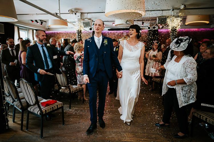 Bride Groom Glitter Sparkling Confetti Ceremony Aisle   Glitter Dinosaurs City Wedding https://struvephotography.co.uk/