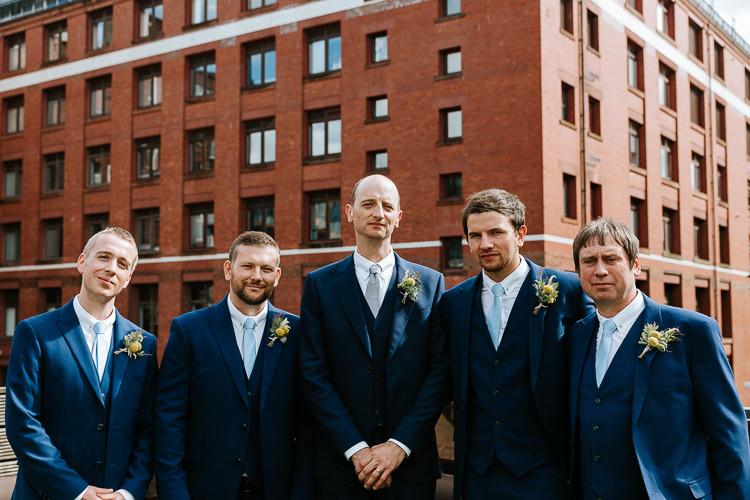 Groom Groomsmen City Group Photo Blue Navy Suits Buttonhole   Glitter Dinosaurs City Wedding https://struvephotography.co.uk/