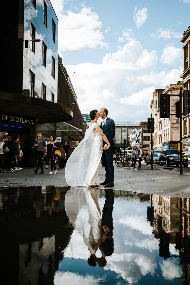 Bride Groom Caped Dress City Street Photography Puddle Reflection | Glitter Dinosaurs City Wedding https://struvephotography.co.uk/