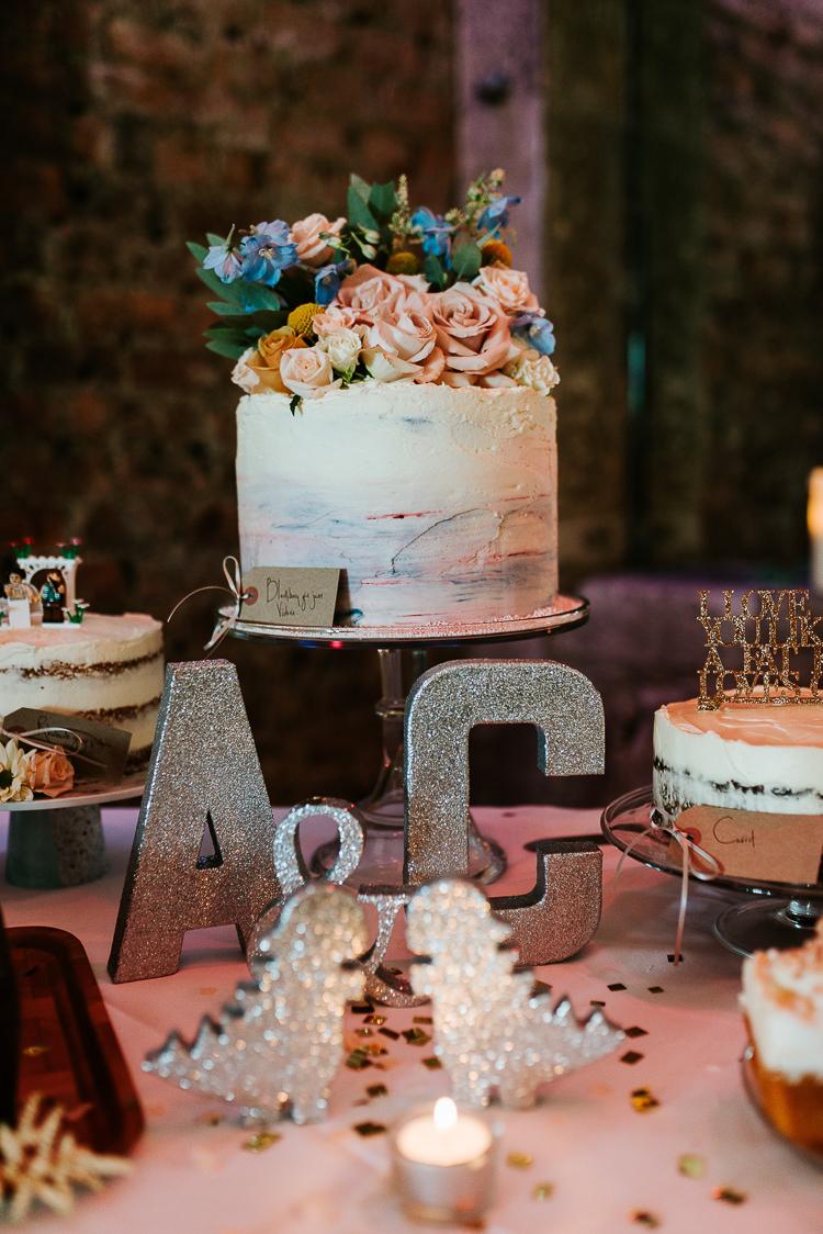 Wedding Cakes Dessert Table Fresh Flowers Toppers Gold Glitter Letters   Glitter Dinosaurs City Wedding https://struvephotography.co.uk/