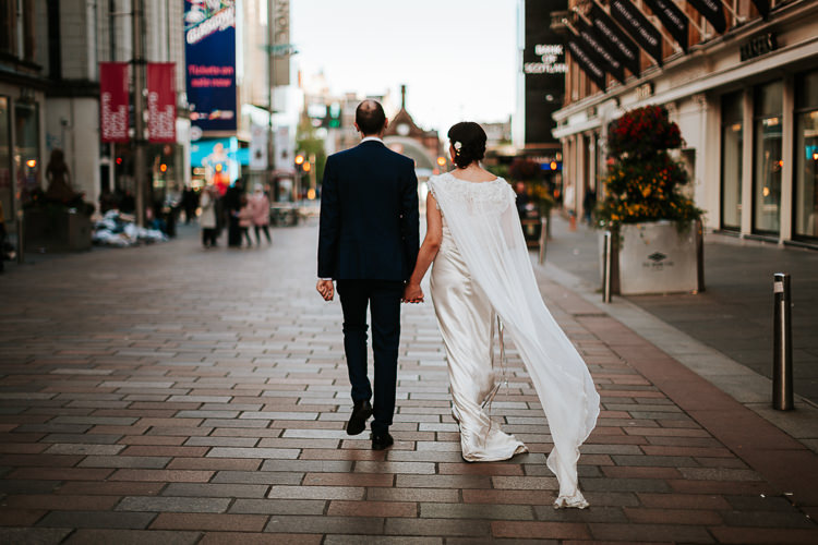 Bride Groom Walk City Street Photography Glasgow Scotland Cape Dress   Glitter Dinosaurs City Wedding https://struvephotography.co.uk/