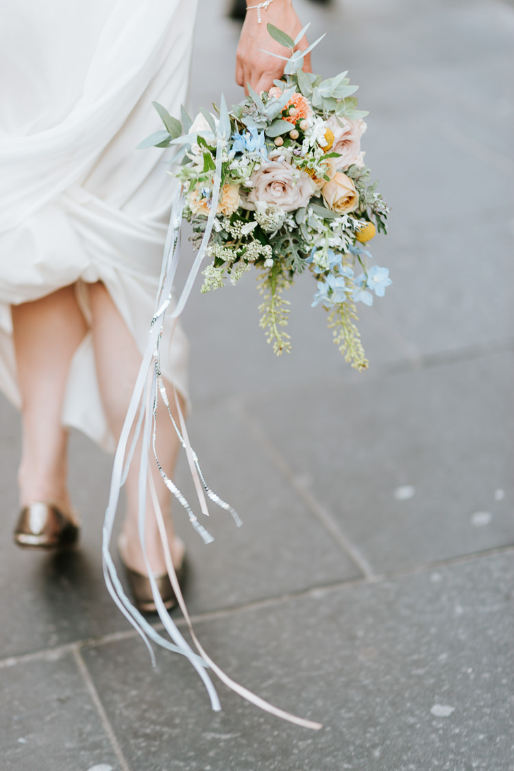 Bride Gold Flat Shoes Pastel Wildflower Bouquet City Urban Quirky | Glitter Dinosaurs City Wedding https://struvephotography.co.uk/