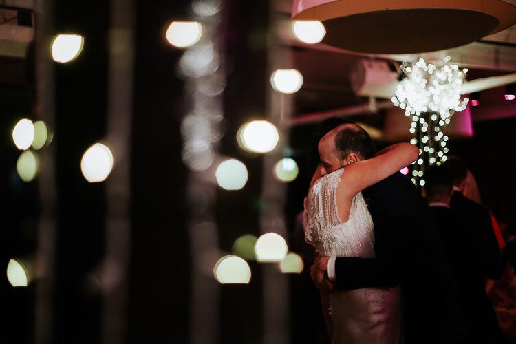 Bride Groom First Dance Embrace Lights Urban Venue   Glitter Dinosaurs City Wedding https://struvephotography.co.uk/