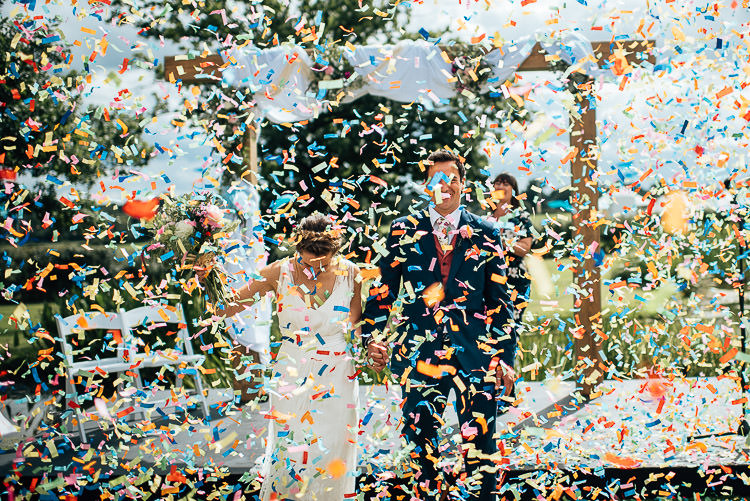 Confetti Cannon Bomb Festival Bohemian Glamping Wedding https://theshannons.photography/
