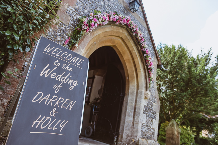 Church Welcome Sign Floral Arch Colourful Creative Vintage Railway Wedding http://joemallenphotography.co.uk/
