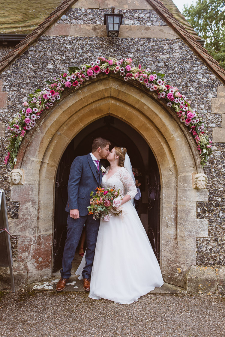 Groom Style Blue Tweed Suit Pink Tie Pocket Square Three Piece Waistcoat Bride Bridal Maggie Sottero Sleeves Sweetheart Neckline Bouquet Silk Ribbon Church Floral Arch Entrance Colourful Creative Vintage Railway Wedding http://joemallenphotography.co.uk/