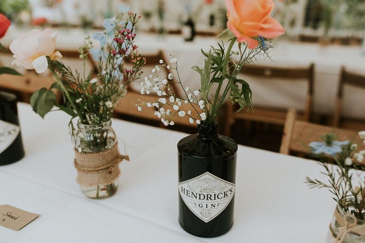 Gin Bottle Flowers Bright Colourful DIY Back Garden Wedding http://jonnymp.com/