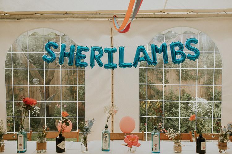 Balloons Name Backdrop Table Bright Colourful DIY Back Garden Wedding http://jonnymp.com/