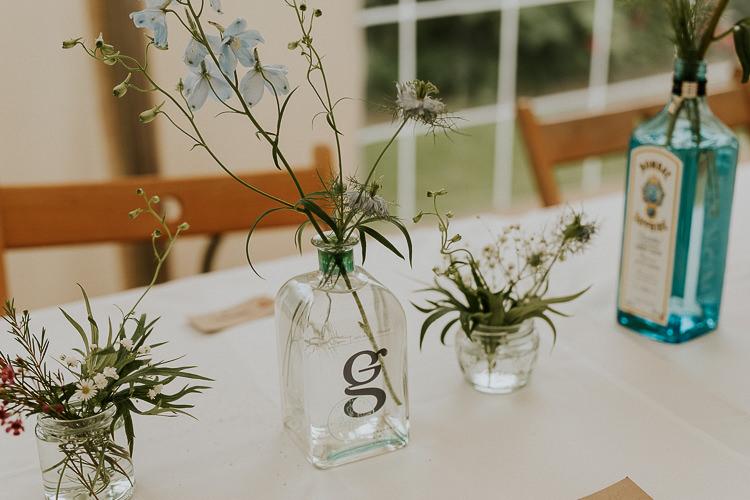 Bottle Flowers Table Decor Bright Colourful DIY Back Garden Wedding http://jonnymp.com/
