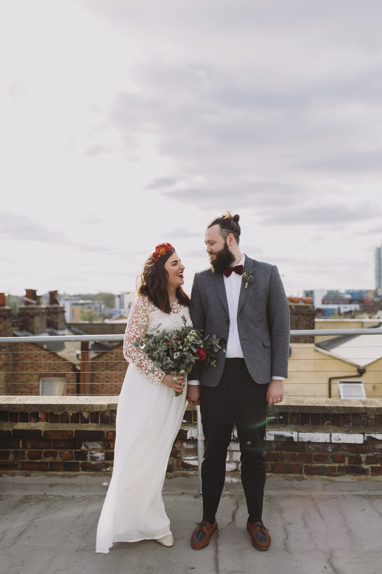 Bride Bridal Dress Gown Lace Long Sleeve Sweetheart Bouquet Red Burgundy Rose Greenery Eucalyptus Flower Crown Tweed Grey Groom Mismatched Bow Tie Alternative London Warehouse Wedding https://www.lukehayden.co.uk/