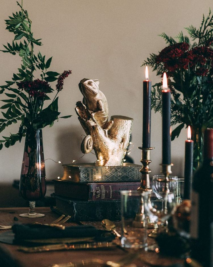 Black Candles Candlesticks Gold Animals Spray Painted Books Vintage Antique Table Setting Fairy Lights Opulent Eccentric Berry Gold Wedding https://mattaustinimages.co.uk/