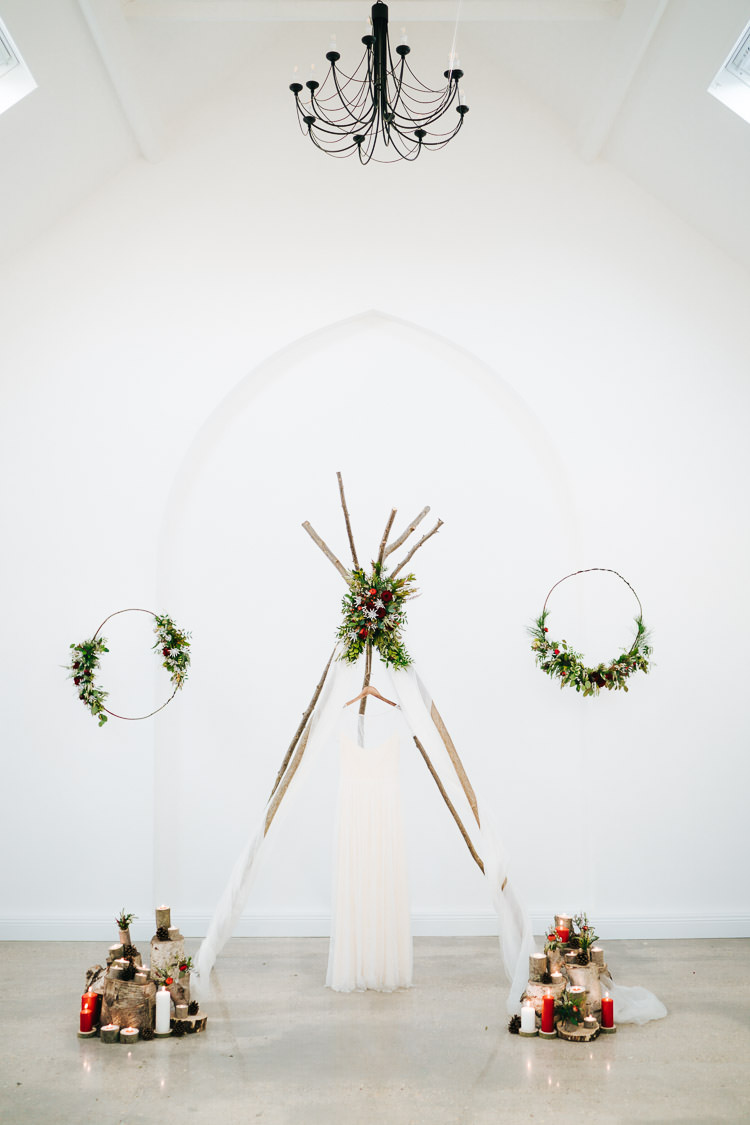 Naked Tipi Backdrop Red Green Winter Wonderland Wedding Ideas http://www.angelawardbrown.com/