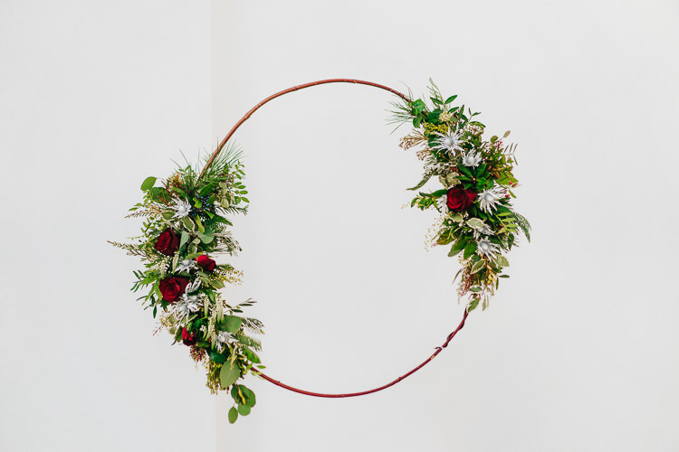 Flowers Greenery Folliage Rose Hoop Wreath Red Green Winter Wonderland Wedding Ideas http://www.angelawardbrown.com/