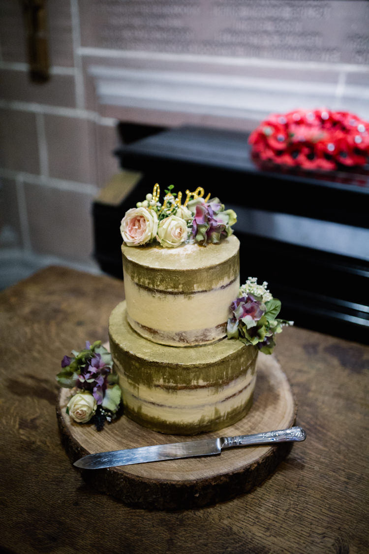 Gold Buttercream Cake Tiered Flowers Floral Laser Cut Topper Wood Slice Playful Metallic Zoo Winter Wedding https://www.jennbrookesphotographer.com/