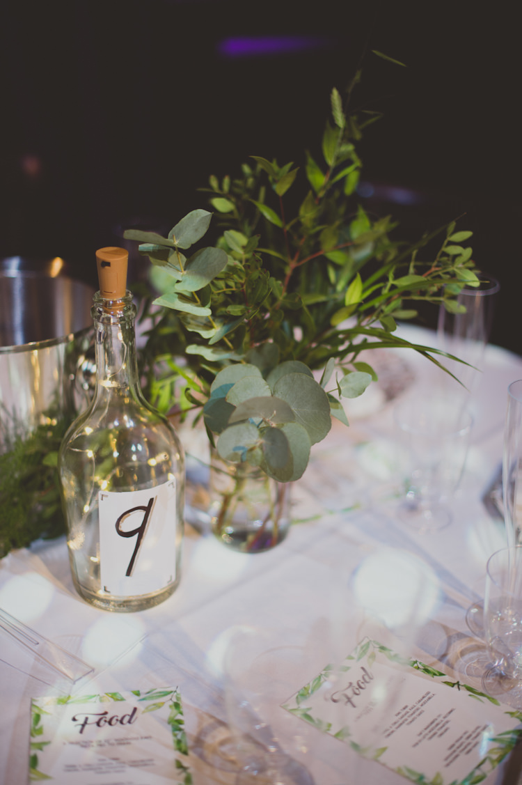 Centrepiece Flowers Greenery Bottle Table Number Botanical Gold Sequin Music Hall Wedding http://sashaweddings.co.uk/