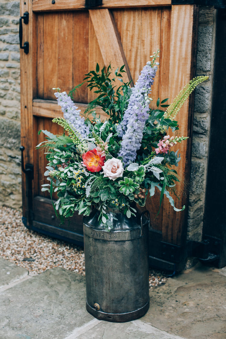 Milk Churn Flowers Pink Blue Greenery Ceremony Outdoor Flowery Bohemian Secret Garden Wedding https://caseyavenue.co.uk/