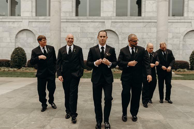 Groom Groomsmen Black Suits Group Photo City Building Outdoors | Urban Industrial Luxe Wedding http://hellencophotos.com/