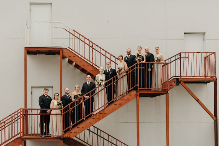 Modern City Bride Groom Bridemaids Groomsmen Staircase The Foundry Puritan Mill | Urban Industrial Luxe Wedding http://hellencophotos.com/