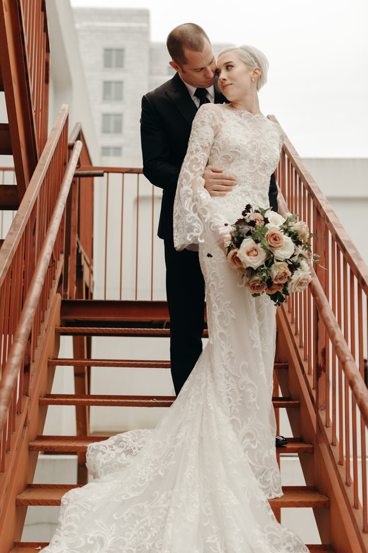 Modern City Bride Groom Staircase The Foundry Puritan Mill | Urban Industrial Luxe Wedding http://hellencophotos.com/