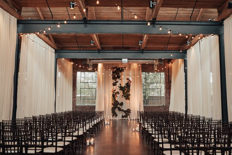 Modern Stylish Chic Geometric Ceremony Aisle Installation Backdrop Moss Candles Warehouse | Urban Industrial Luxe Wedding http://hellencophotos.com/