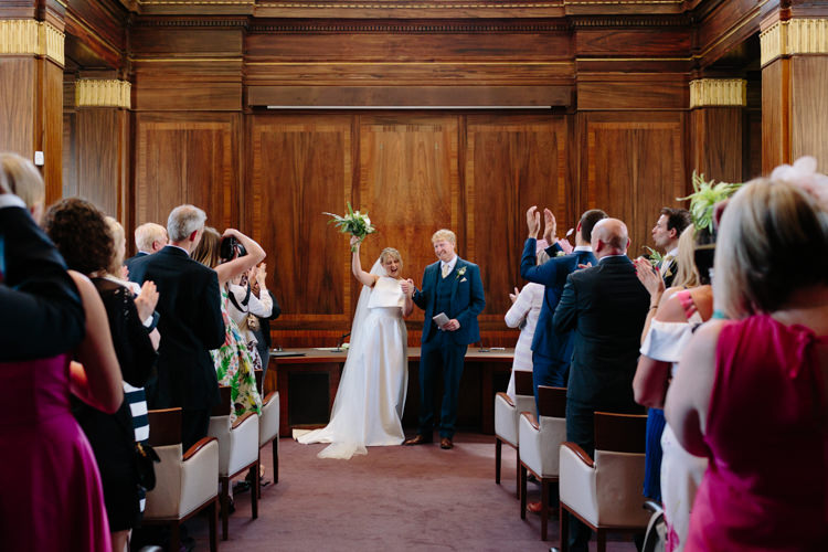 London Stoke Newington Town Hall Aisle Civil Ceremony Bride Groom Celebrate Happy | Modern Tropical Gold Urban Wedding https://www.christinewehrmeier.com/
