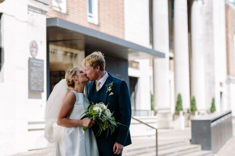 Sunny North London Stoke Newington Town Hall Bride Groom Outdoor Photographs Kiss | Modern Tropical Gold Urban Wedding https://www.christinewehrmeier.com/