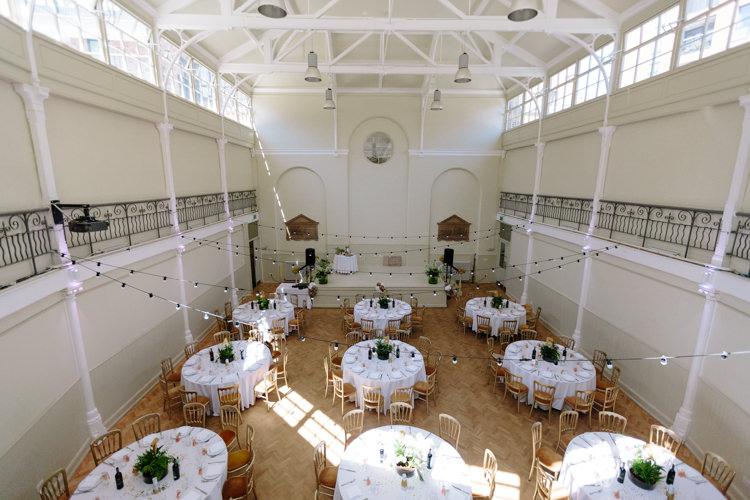 London Shoreditch The Tab Centre Wedding White Gold Green Tropical Festoon Lights Paper Pompoms | Modern Tropical Gold Urban Wedding https://www.christinewehrmeier.com/