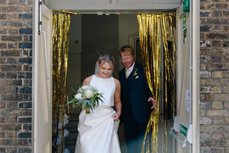 London City Urban Gold Glitter Curtain Bride Groom Foliage Green Bouquet Simple Jesus Peiro Dress | Modern Tropical Gold Urban Wedding https://www.christinewehrmeier.com/