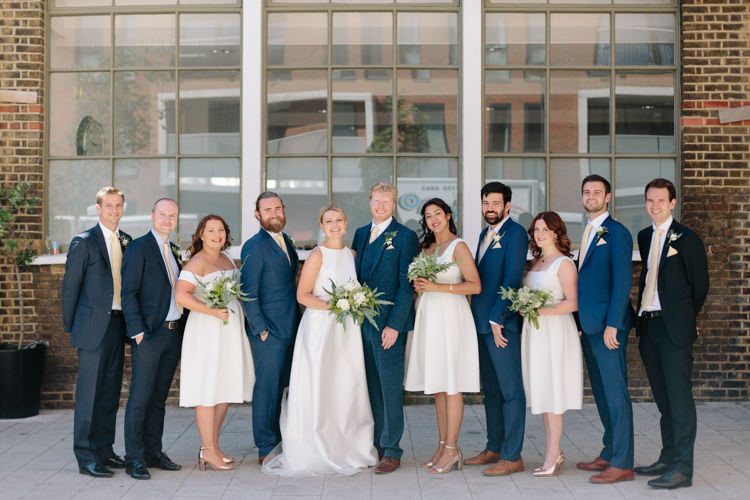 Bride Jesus Peiro Dress White Bridesmaids ASOS Simple Foliage Greenery Gold Bouquet Groom Groomsmen Navy Suit | Modern Tropical Gold Urban Wedding https://www.christinewehrmeier.com/