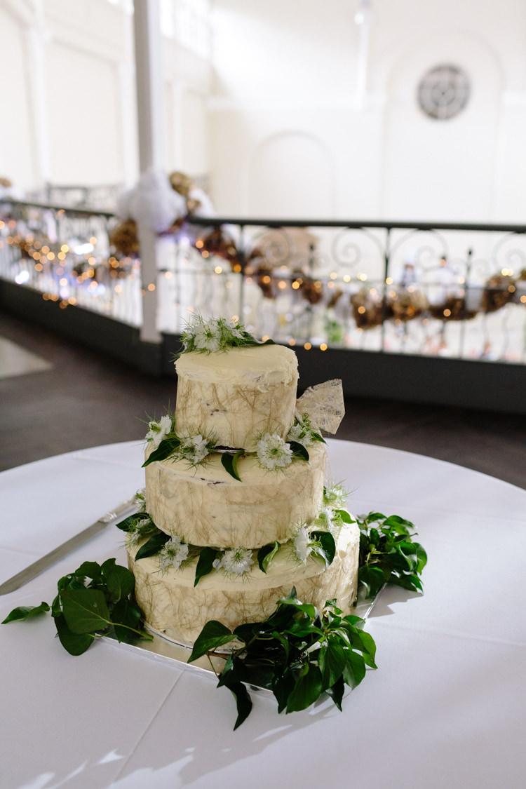 Chocolate Fudge Homemade Cake White Green Tropical Fresh Flowers Leaves | Modern Tropical Gold Urban Wedding https://www.christinewehrmeier.com/