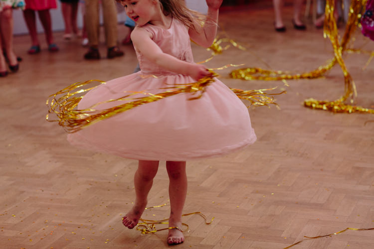 Dance Floor Gold Ribbon Curtain Dancing Girl Kids | Modern Tropical Gold Urban Wedding https://www.christinewehrmeier.com/