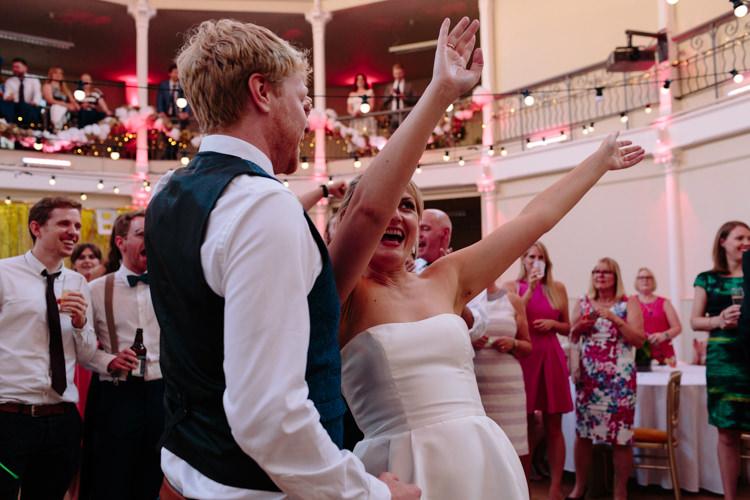 London Shoreditch The Tab Centre Wedding White Gold Green Tropical Festoon Lights Paper Pompoms First Dance | Modern Tropical Gold Urban Wedding https://www.christinewehrmeier.com/