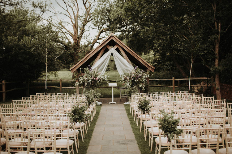 Outdoor Ceremony Flowers Arch Backdrop Silvery Grey Nature Wedding https://jonathanellisblog.com/