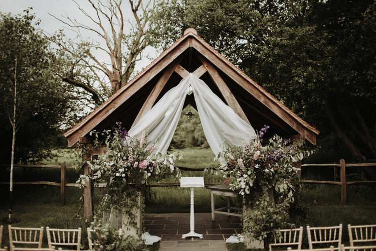 Frame Arch Flowers Backdrop Ceremony Silvery Grey Nature Wedding https://jonathanellisblog.com/