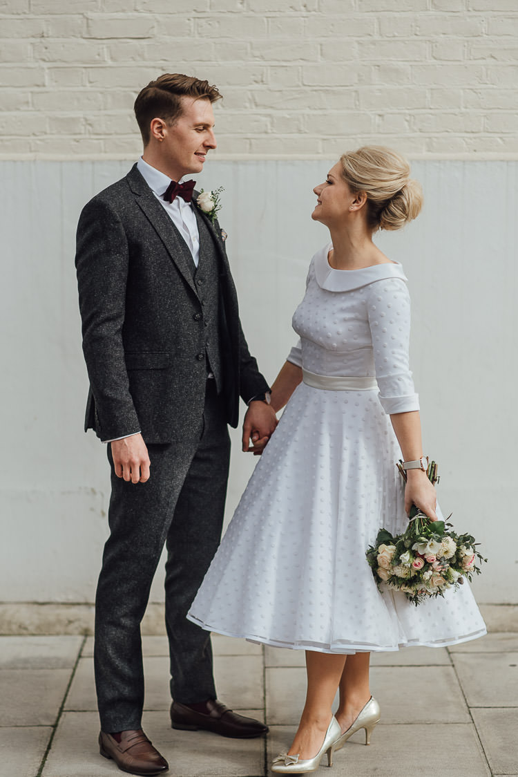 Bride Bridal Candy Anthony Polka Dot Peter Pan Collar Tea Length Groom Three Piece Suit Waistcoat Grey Tweed Burgundy Bow Tie Pocket Square Bouquet Chic Relaxed London Pub Wedding https://theshannons.photography/
