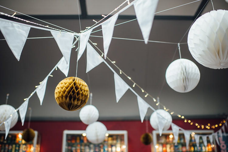 Bunting Paper Lanterns Fairy Lights Chic Relaxed London Pub Wedding https://theshannons.photography/
