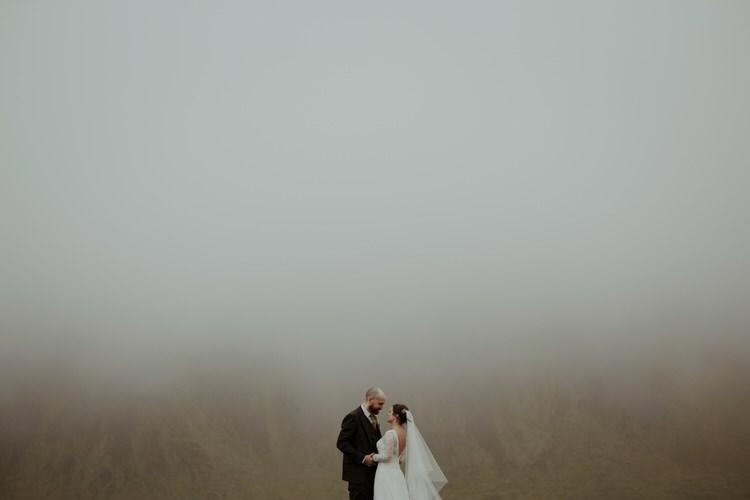 Bride Groom Destination Elopement Nordic Outdoor Fog Field Cliff Coast Sea Minimalist Style | Intimate Adventurous Emotional Iceland Wedding http://www.thecurries.co/