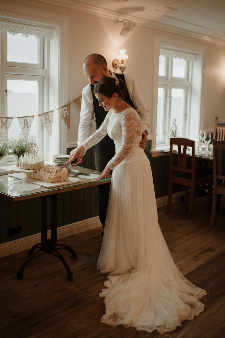 Bride Groom Destination Elopement Neutral Elegant Simple Minimalist Decor Restaurant Reception Cake Cutting | Intimate Adventurous Emotional Iceland Wedding http://www.thecurries.co/