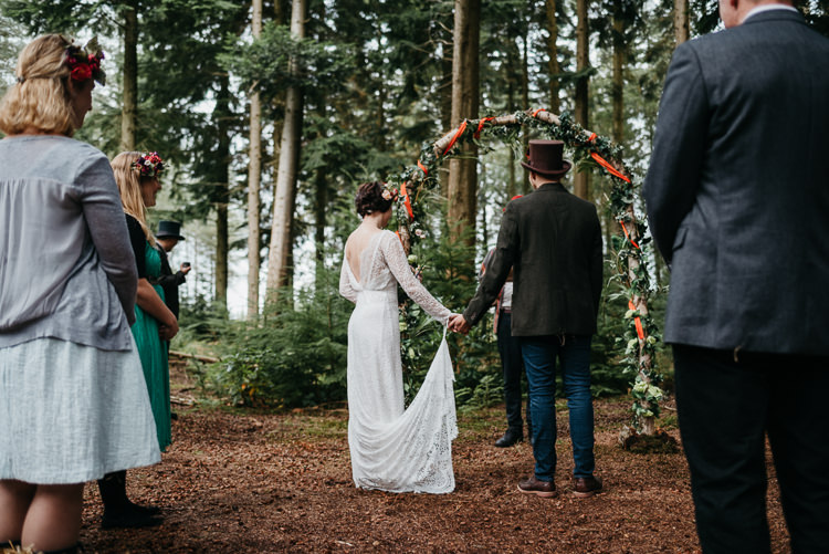 Bride Bridal Vintage Lace Dress Long Sleeved Flower Crown Bouquet White Stuff Groom No Tie Waistcoat Three Piece Suit Top Hat Tweed Foliage Flower Arch Folky Woodland Adventure Wedding https://elainewilliamsphoto.com/