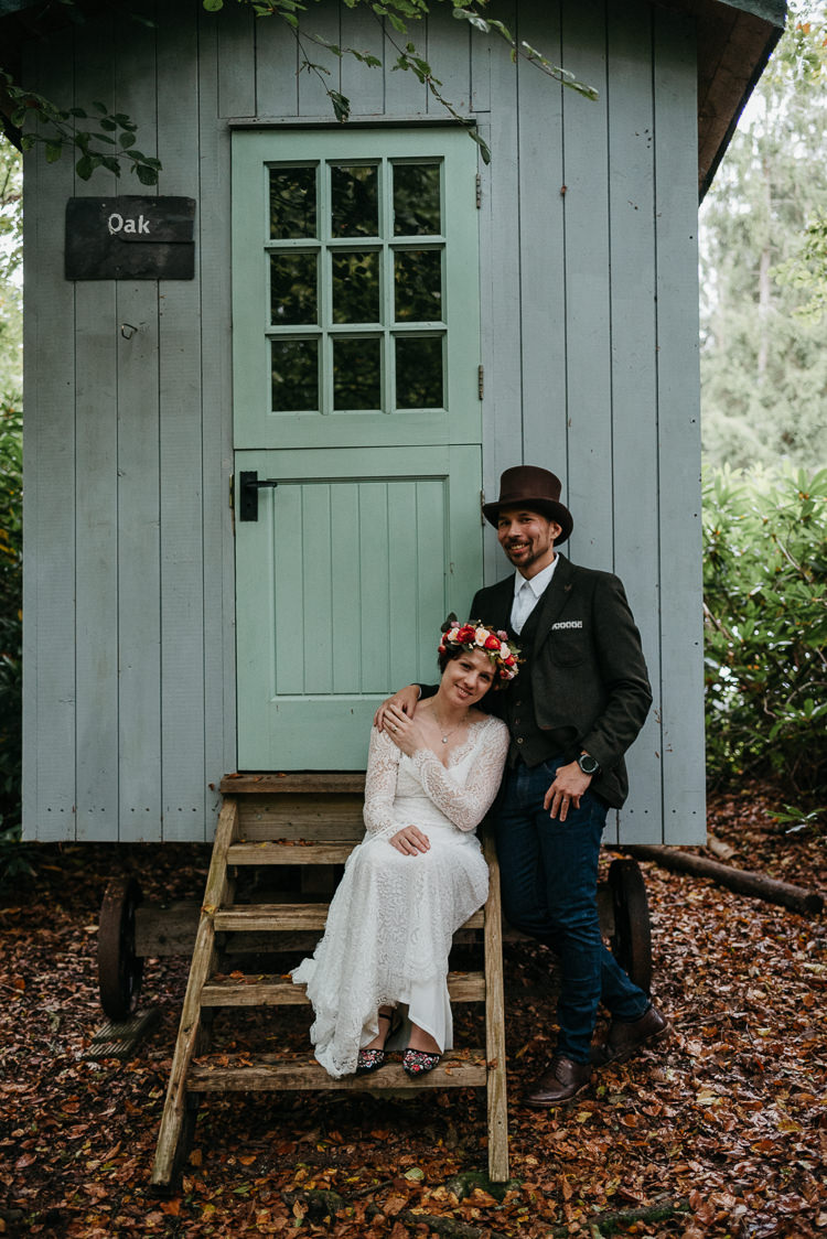 Bride Bridal Vintage Lace Dress Long Sleeved Flower Crown Bouquet White Stuff Groom No Tie Waistcoat Three Piece Suit Top Hat Tweed Shepherds Hut Folky Woodland Adventure Wedding https://elainewilliamsphoto.com/