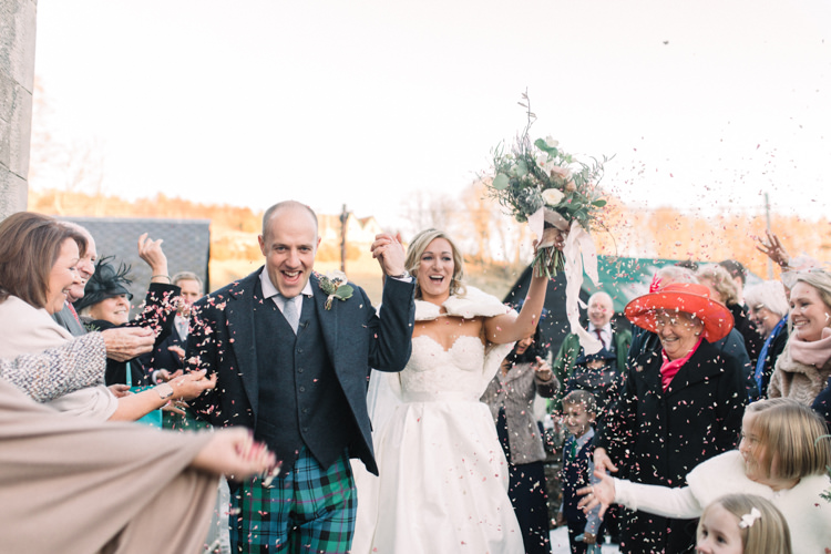 Bride Bridal Sweetheart Neckline Hair Piece Lace A Line Faux Fur Stole Cape Tartan Trousers Groom Three Piece Waistcoat Tweed Jacket Confetti Shot Enchanted Magical Snowy Wedding https://www.thegibsonsphotography.co.uk/