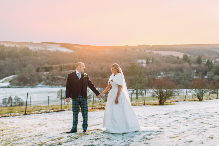 Bride Bridal Sweetheart Neckline Hair Piece Lace A Line Faux Fur Stole Cape Tartan Trousers Groom Three Piece Waistcoat Tweed Jacket Enchanted Magical Snowy Wedding https://www.thegibsonsphotography.co.uk/