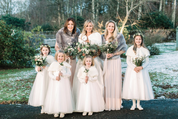 Bride Bridal Sweetheart Neckline Hair Piece Lace A Line Faux Fur Stole Cape Bridesmaids Dessy Pink Blush Dress Floor Length Fur Stole Cape Flower Girls White Floral Wand Enchanted Magical Snowy Wedding https://www.thegibsonsphotography.co.uk/