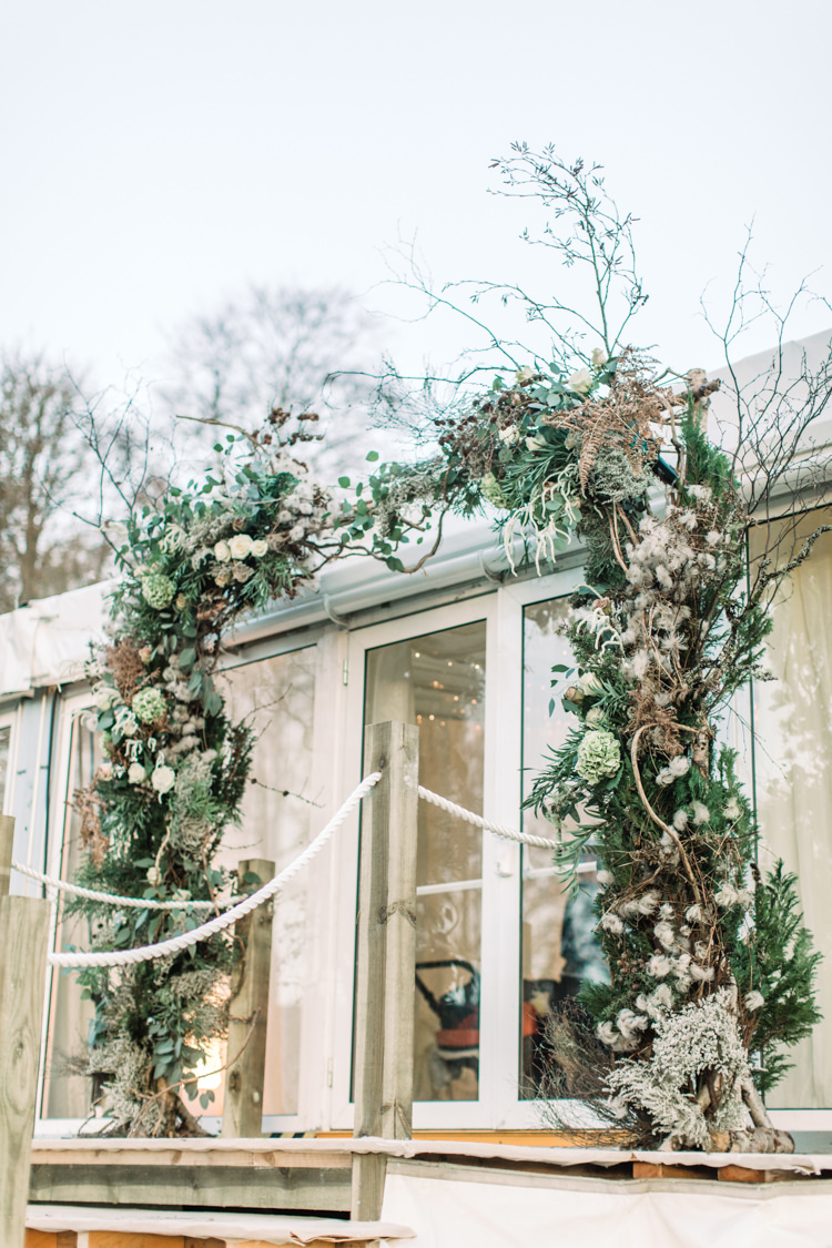 Floral Foliage Arch Twigs Marquee Enchanted Magical Snowy Wedding https://www.thegibsonsphotography.co.uk/