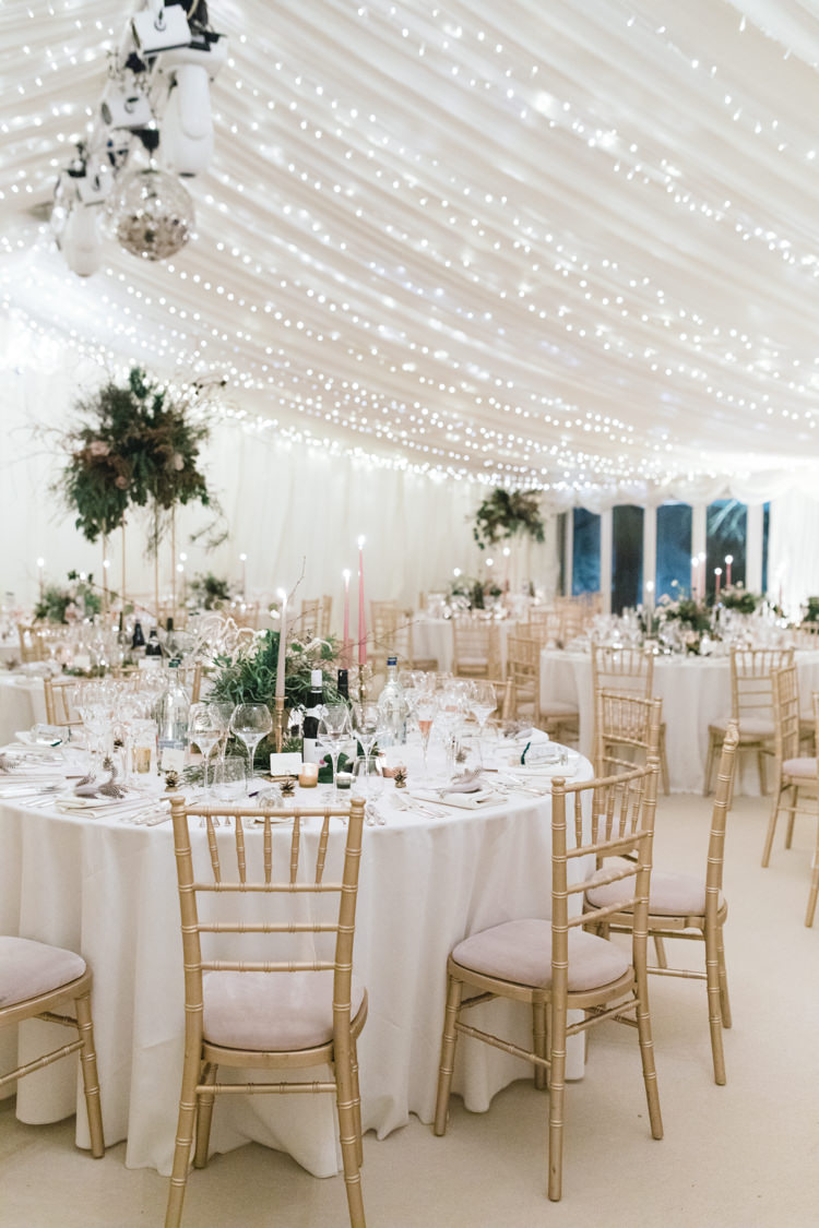 Starry Fairy Lights Marquee Pastel Candlesticks Pedestal Flowers Enchanted Magical Snowy Wedding https://www.thegibsonsphotography.co.uk/